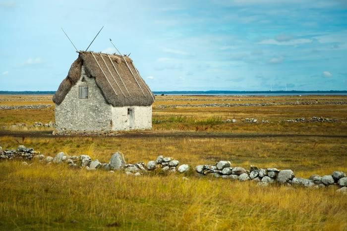 Stone Hut with Grass Roof, Gotland, Sweden shutterstock_1629943645.jpg