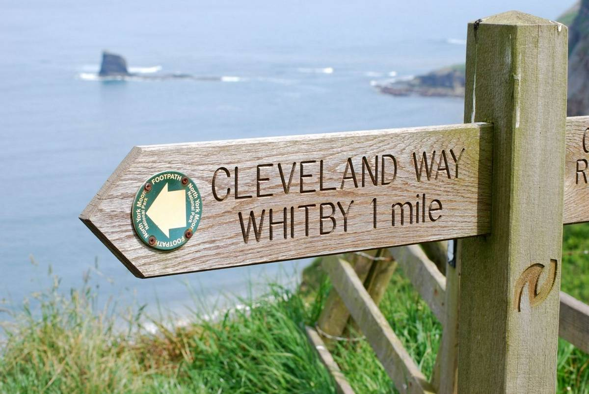 Cleaveland way signpost on edge of cliff outside Whitby, North Yorkshire, UK.