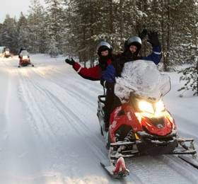 Snowmobiling and discovering the Aurora