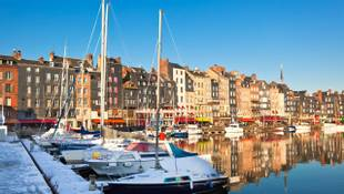 Honfleur harbour in Normandy, France. Color houses and their reflection in water. another Honfleur shots available