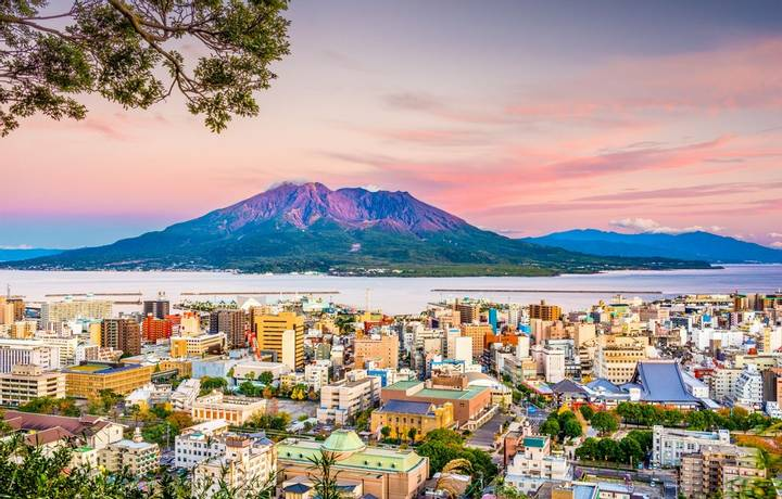 Kagoshima, Japan skyline with Sakurajima Volcano at dusk.