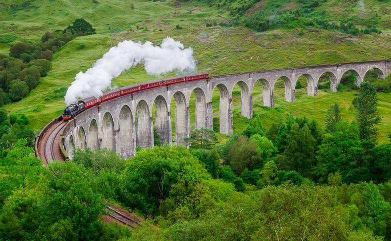Detail of steam train on famous Glenfinnan viaduct, Scotland
