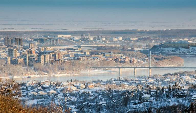 Novi Sad, Serbia - January 27, 2019: Panoramic view of Novi Sad and its suburbs covered with snow during Winter oh nice sunn…