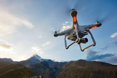 Drone flying through hills or mountains