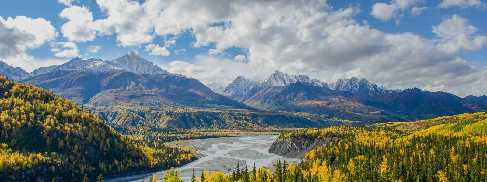 The Matanuska River flows below the Chugach Mountains in Alaska