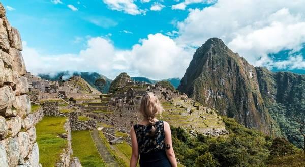A woman walking towards Machu Picchu