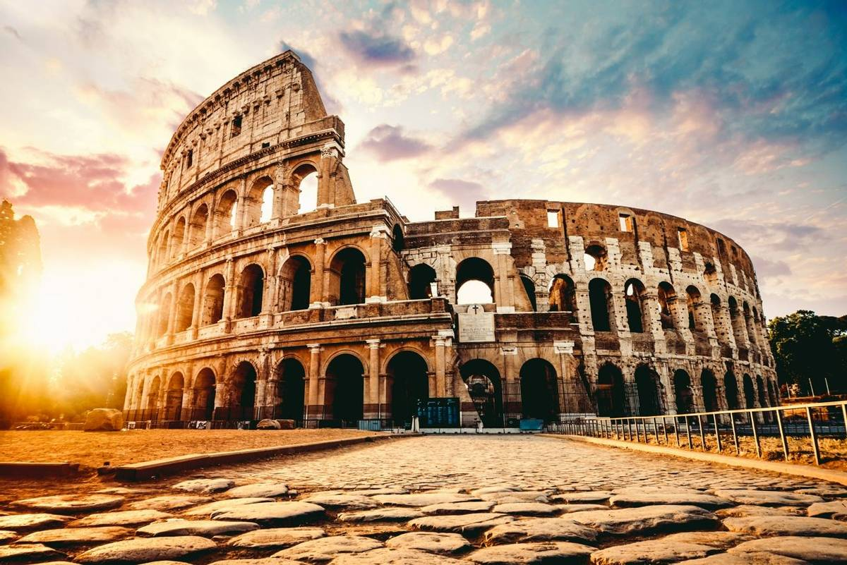 The ancient Colosseum in Rome at sunset