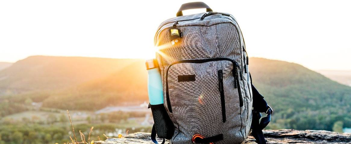 A backpack with a reusable water bottle