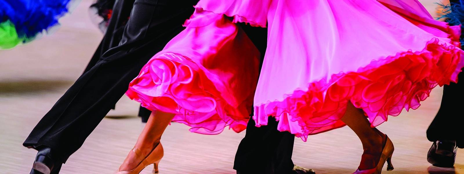competitions in ballroom dancing. black tailcoat and pink ball gown