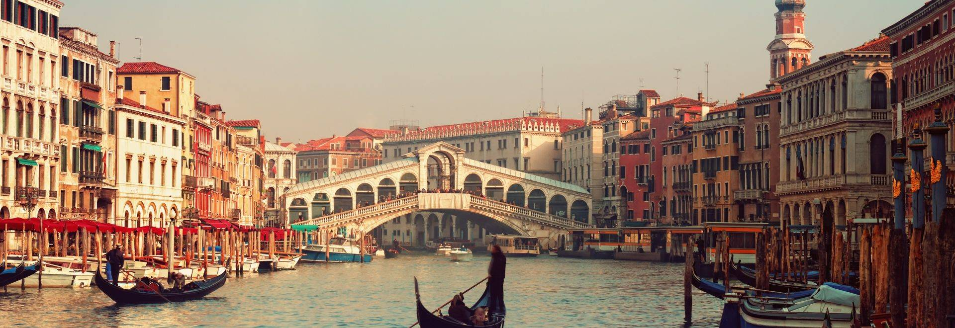 Shutterstock 93566209 Rialto Bridge And Gondolas In Venice