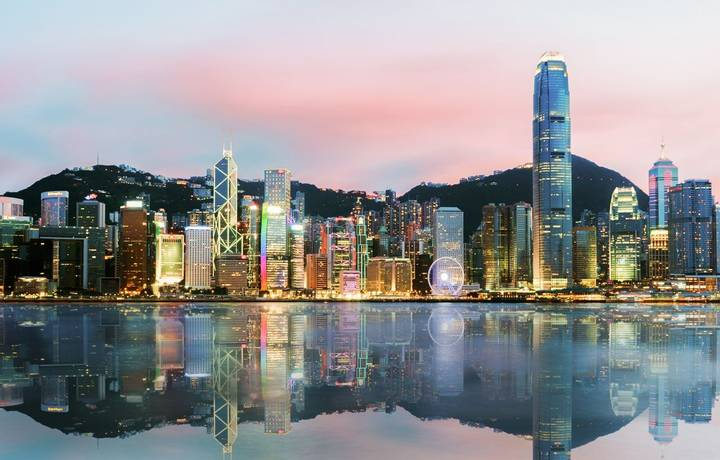 Beautiful Hong Kong, China skyline from across Victoria Harbor.sunset time
