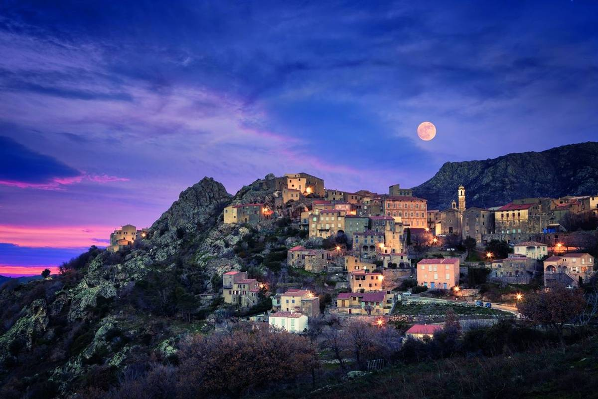 Full moon over Balagne village of Speloncato in Corsica