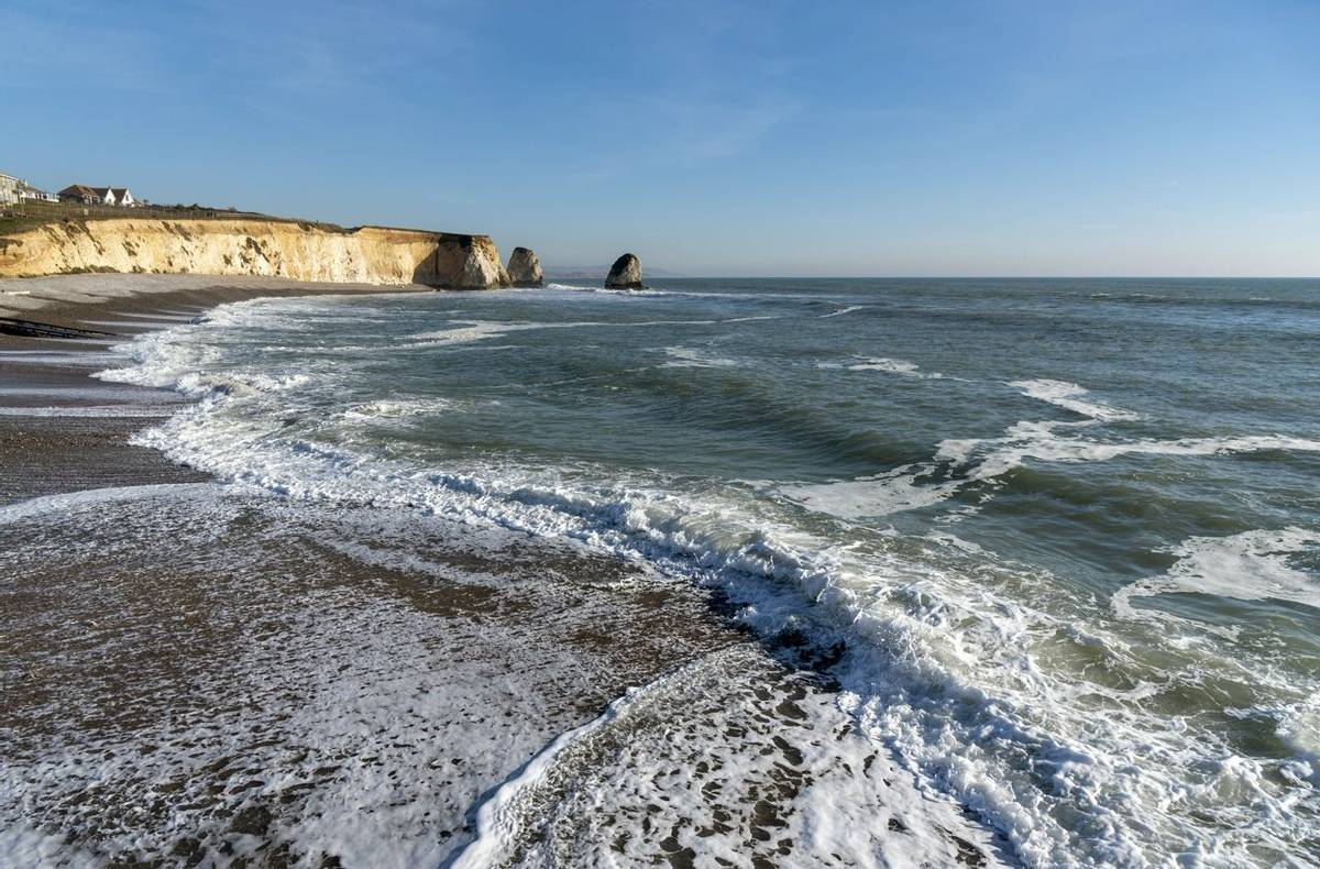 Freshwater Bay, Isle of Wight, England, UK. February 2019. Incoming tide on a winters afternoon on the Isle of Wight