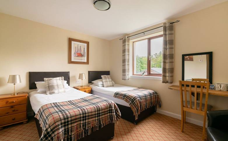 Bedroom Park Lodge Hotel from hotel's website.jpg
