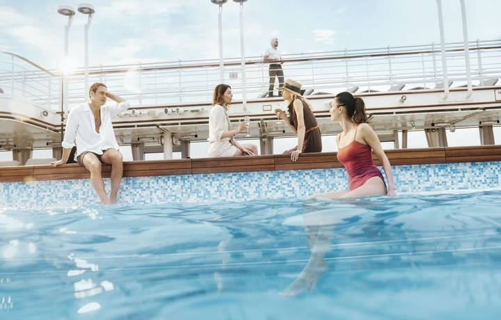 Guests enjoying the pool, Pool Deck, Silver Muse classic