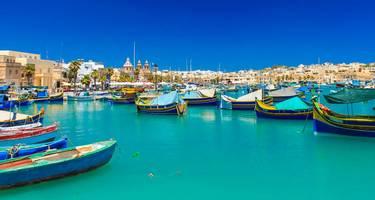 Traditional Luzzu fishing the harbour of Marsaxlokk, Malta