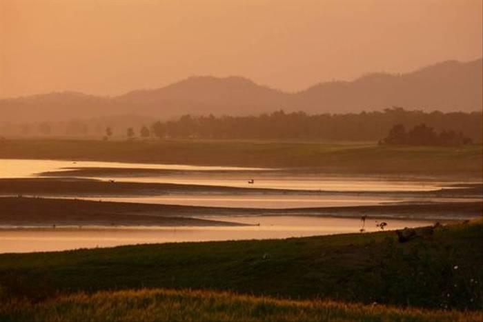 Fisherman at dusk, Satpura