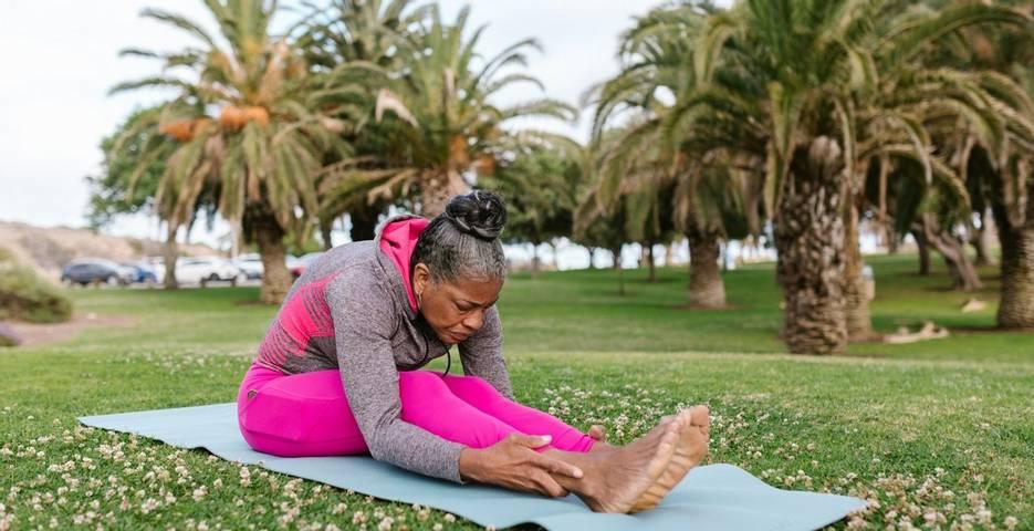 woman doing a folded seat yoga pose