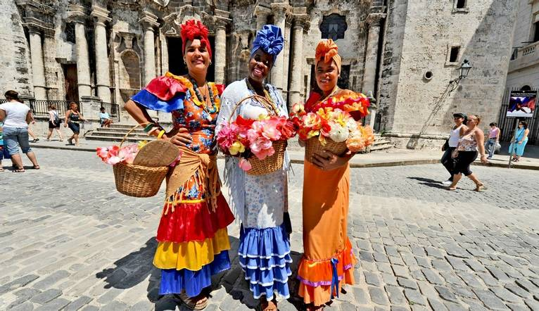 Shutterstock 161673995 Three Cuban Women In Traditional Dresses In Havana,