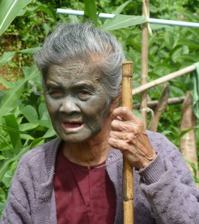 Tattoo faced lady in Chin state