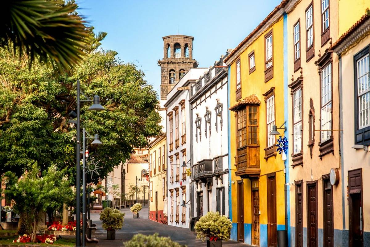 City street view with church tower in La Laguna town on Tenerife island