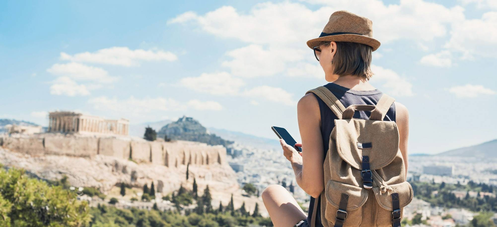 Young woman traveler using mobile phone outdoor