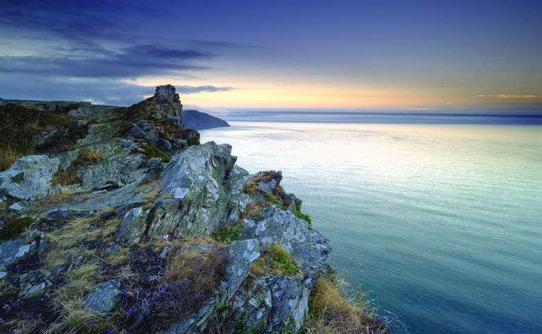 Summer sunset over the Valley of Rocks, near Lynton in the Exmoor National Park, Devon, UK