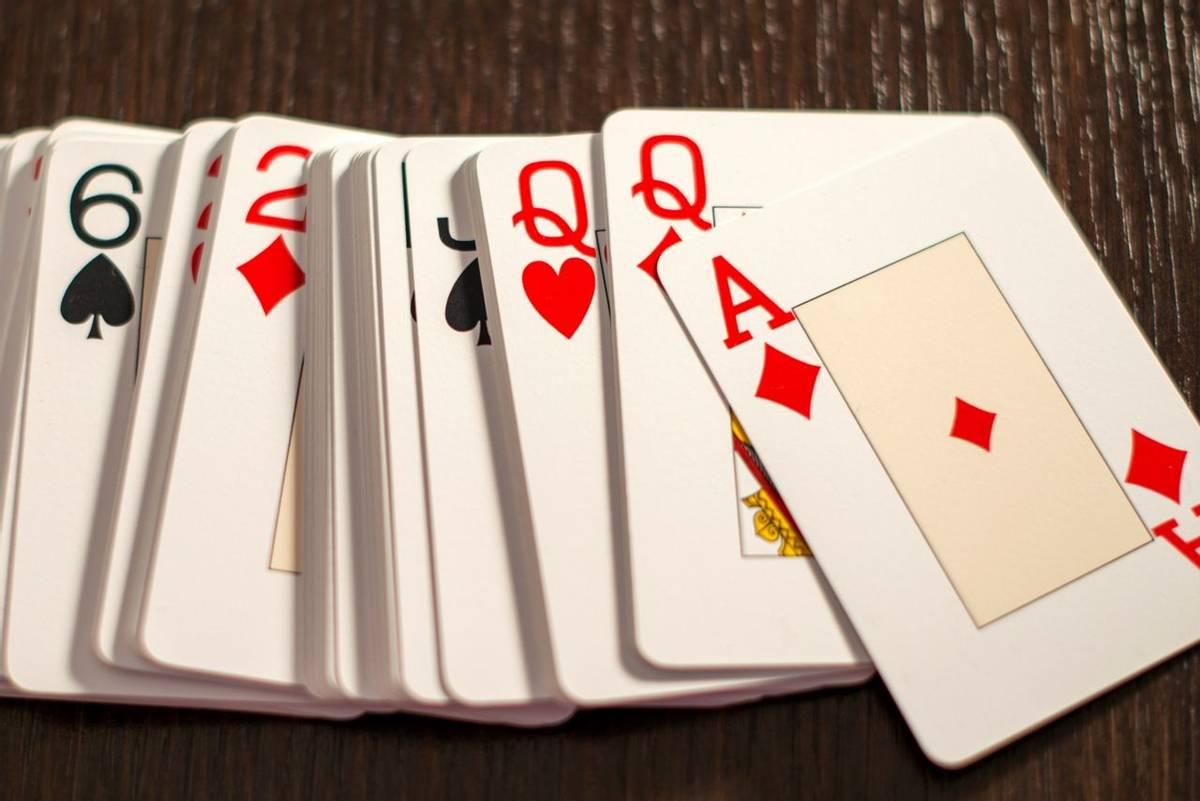 Deck of playing card spread out on a table