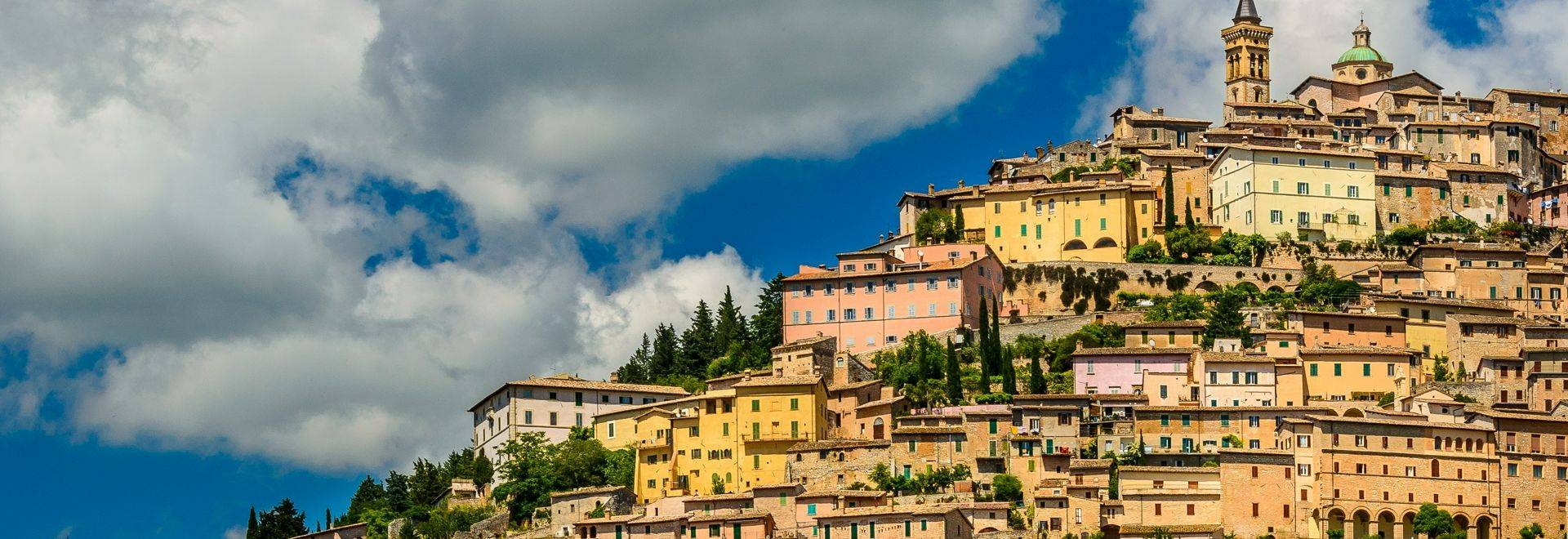 Trevi a town in Umbria, densely inhabited and of decidedly medieval aspect, lies on sharply sloping terrain, commanding asto…