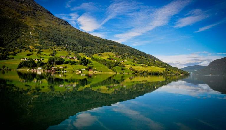 Refection of a fjord in Olden, Norway.