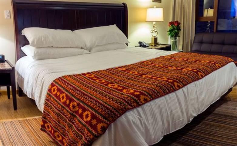 Galapagos & Ecuador - HotelMedinaDelLago-room.jpg