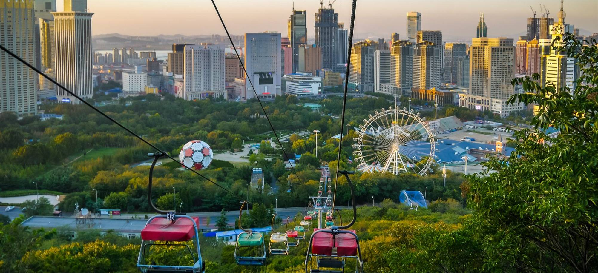 Dalian   Colourful Chairlifts Above The Cityscape   Itinerary Desktop