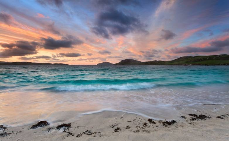 Stunning sunrise over Vatersay beach, Outer Hebrides .