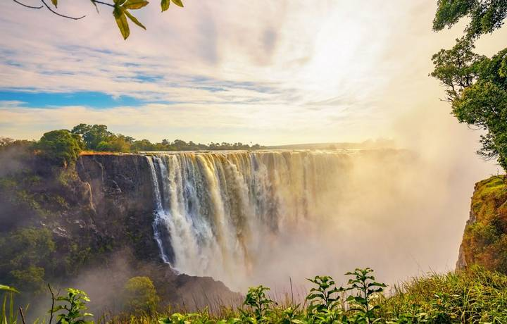 Sunset at the Victoria Falls on Zambezi River located between Zambia and Zimbabwe, the largest waterfall in the world.