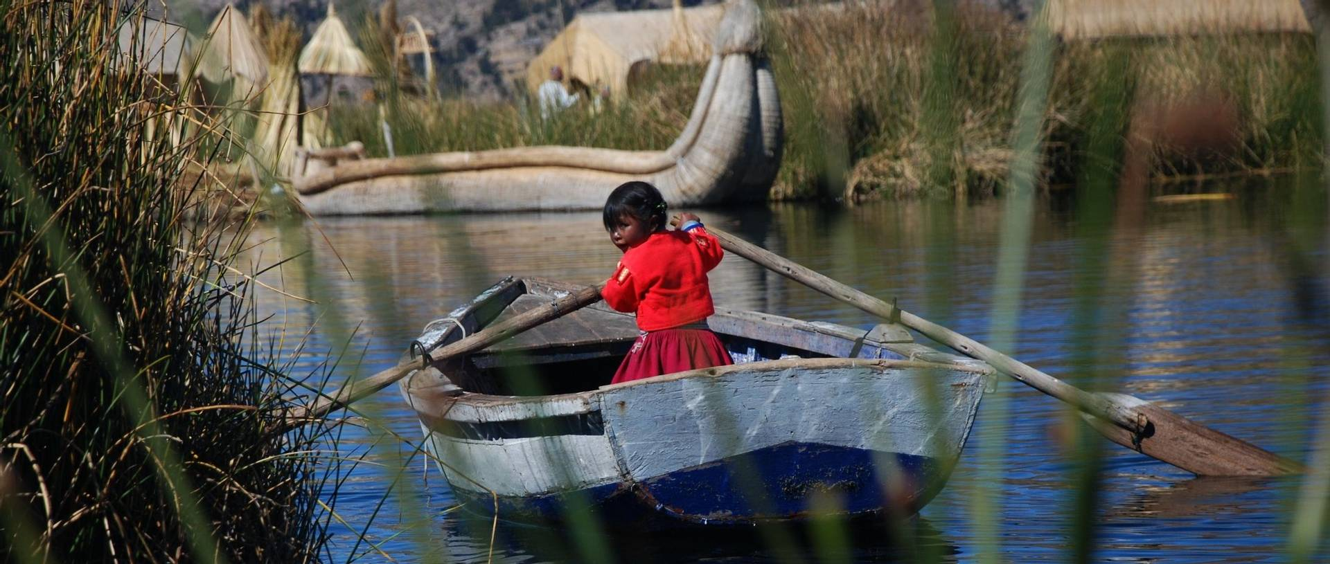 Little Girl In A Boat On Lake Titicaca