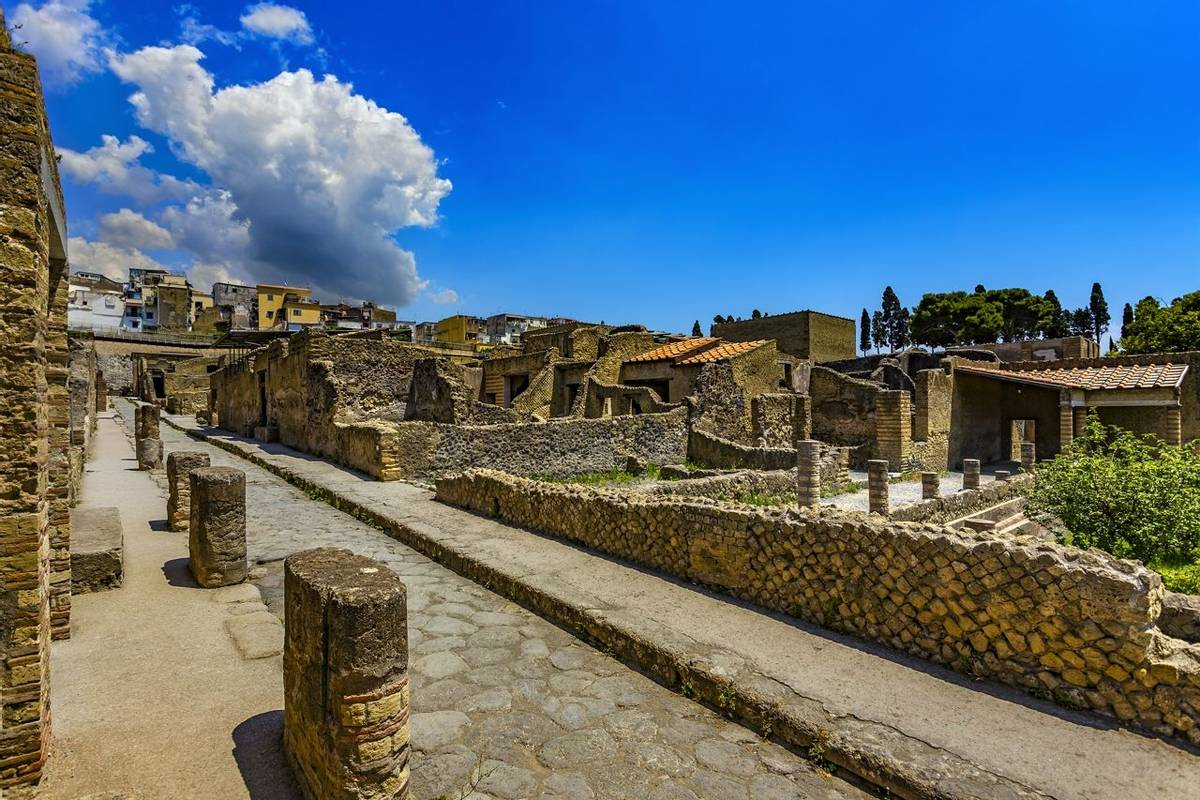 Italy. Ruins of Herculaneum (UNESCO World Heritage Site) - Cardo III Inferiore (lower Cardo street) and remains of ancient h…