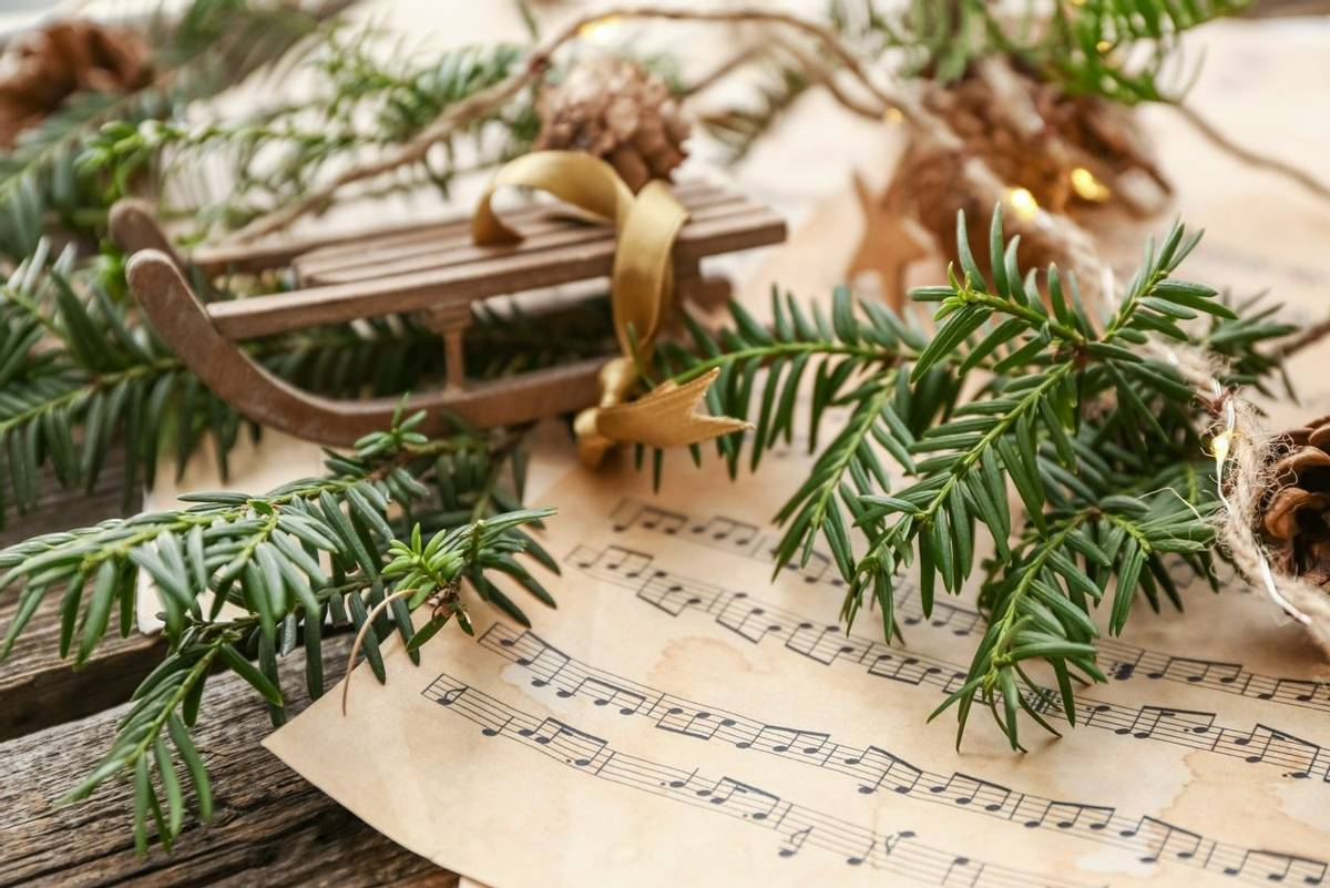 Christmas composition with music notes on wooden table