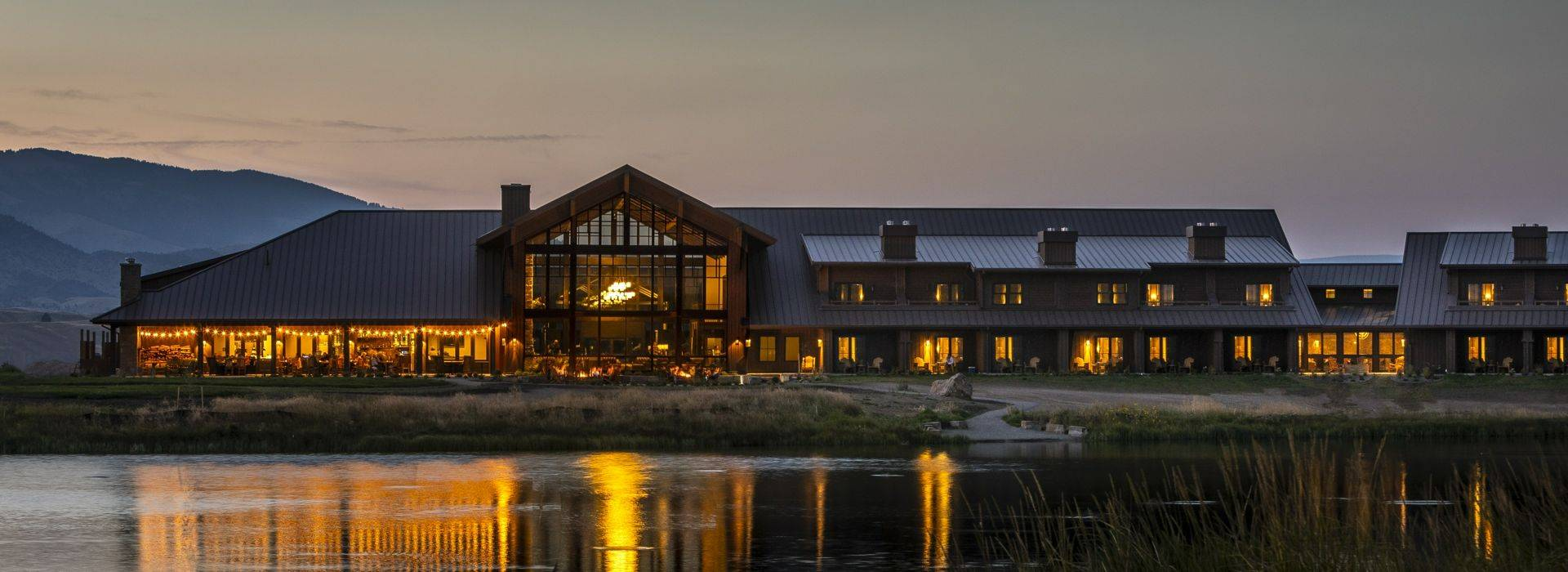 Sage-Lodge-Exterior Overlooking Pond at Dusk.jpg