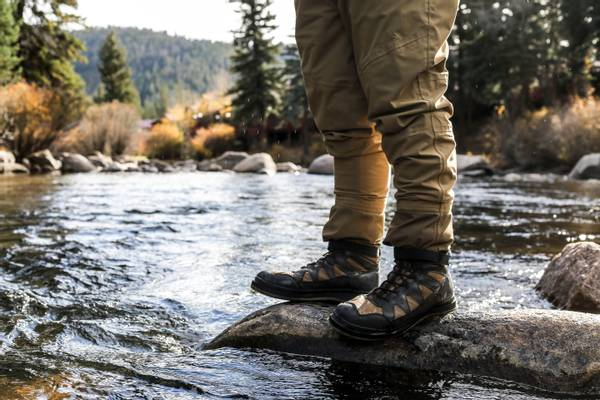 Wearing waterproof hiking boots on river