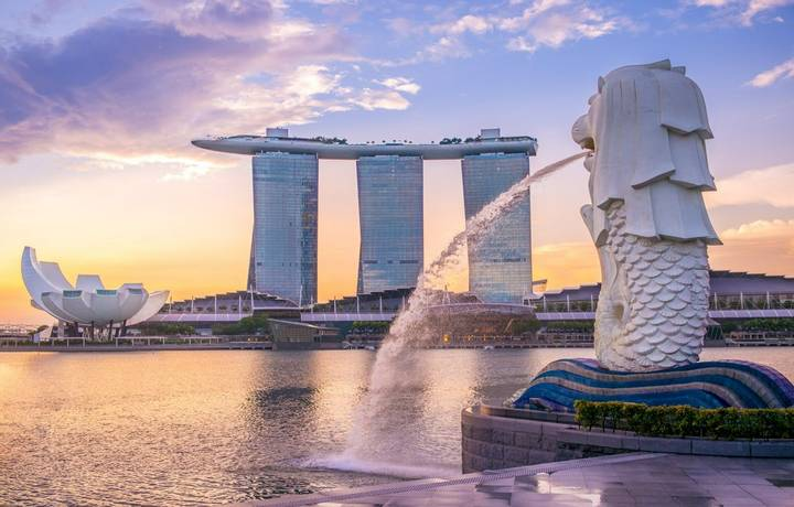 Singapore, Singapore - May 21, 2016: silhouette of Merlion Statue at Marina Bay against the sunrise. Merlion is a well known…