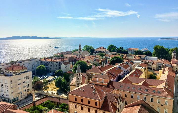 A beautiful view looking down on the old town of Zadar, Croatia from the famous Bell Tower, with the beautiful Adriatic Sea …