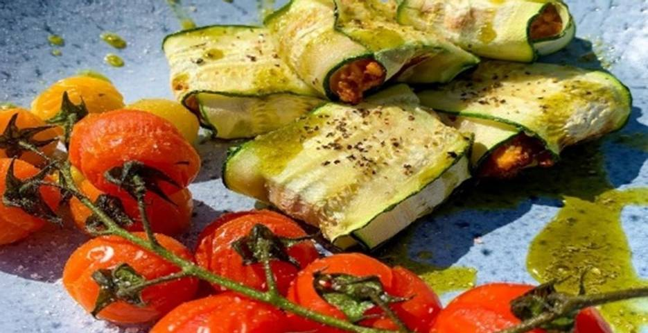 Roasted tomatoes and courgette ravioli drizzled with olive oil