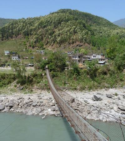 Crossing bridge over Budhi Gandaki river