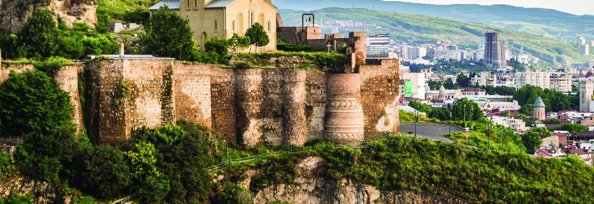 Horizontal Photo Of The Narikala Fortress With The St Nikolas Church And The Architecture In The Surrounding Old Town Of Tbi…