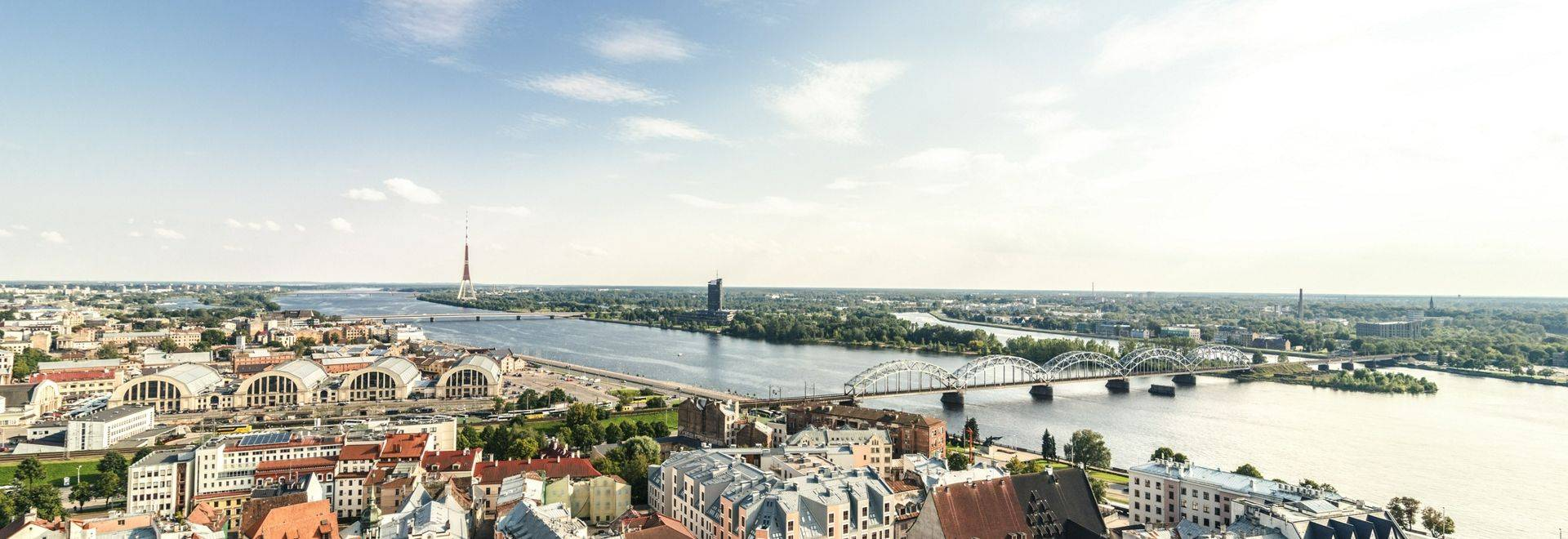 GettyImages-709125603 Latvia, Riga, cityscape with old town, and bridges over Daugava River.jpg