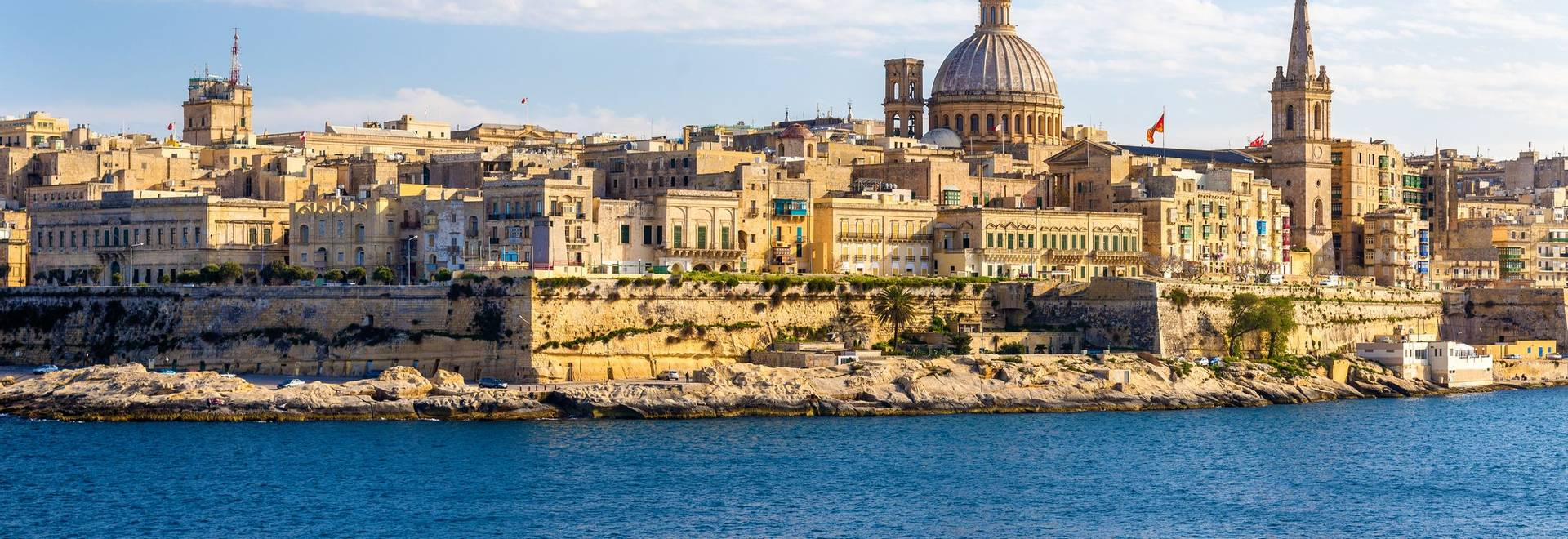 Passenger boat passing Marsamxett Harbour in Malta