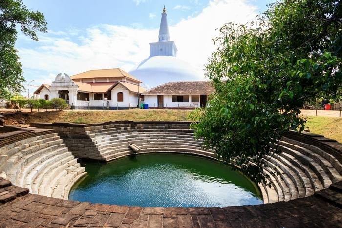 Stepped pool and Buddhist stupa, Anuradhapura, Sri Lanka shutterstock_369653033.jpg