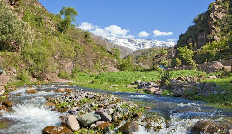River in the high Altas Mountains near Ouirgane, Morocco. This is the valley which leads to Imlil from where visitors head u…