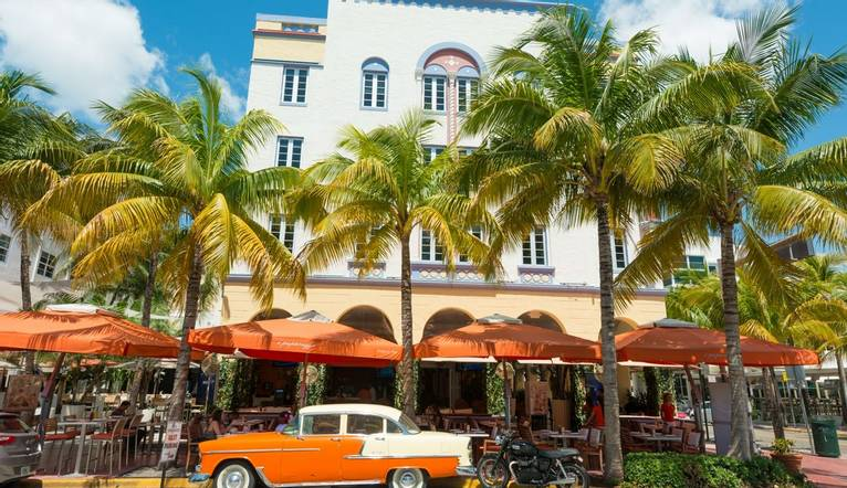Shutterstock 195707819 Vintage Car Parked At Ocean Drive In Miami Beach