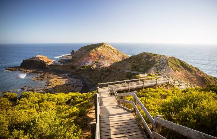The famous Cape Schanck boardwalk runs towards the sea and rock formation known as London Bridge, in Victora. Australia